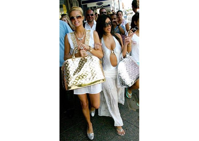 Paris Hilton And Kim Kardashian With Marc Jacobs For Louis Vuitton ' Monogram Miroir' Gold Speedy Handbags In Sydney, Australia, Photo By Photo News International Inc, Getty Images